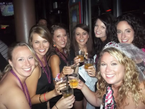 Bachelorette and bridesmaids toasting  at a bachelorette scavenger hunt